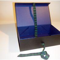 Black and blue gift box with tartan ribbon